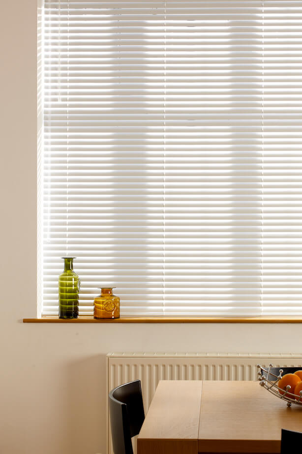 Large white window with a cream Hillarys Venetian blind fitted to it in Portfolio Oatmeal